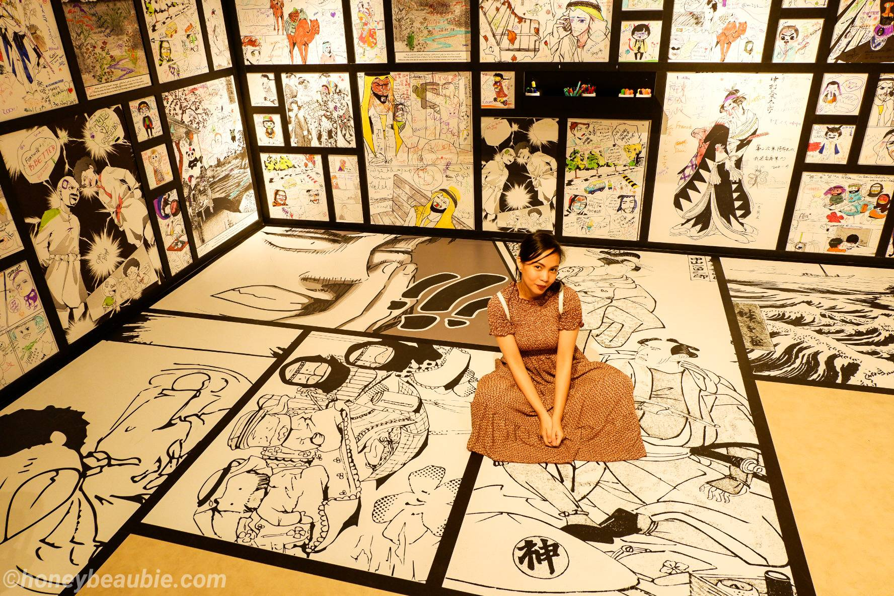me-with-comic-wall-panels-inside-manga-lab-in-louvre-museum-abu-dhabi